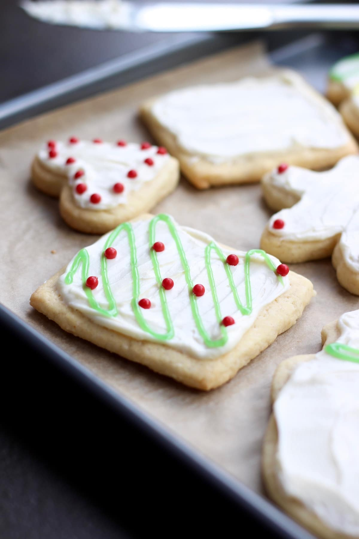 christmas lights on a frosted sugar cookie