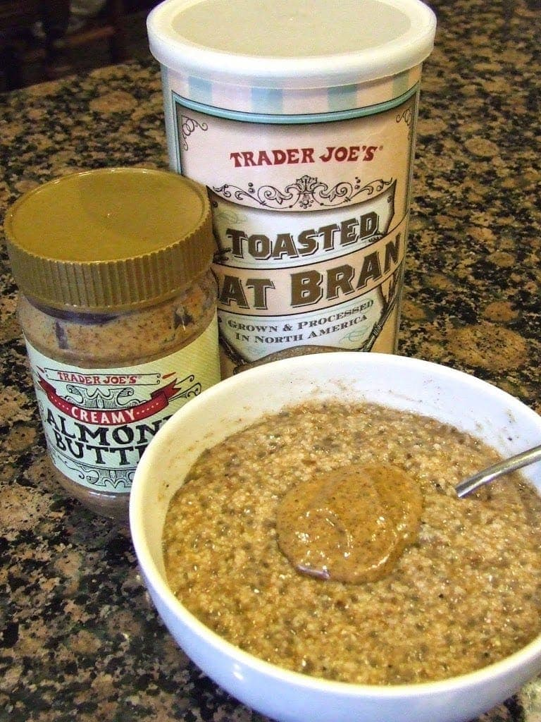 growing oat bran bowl next to trader joe's oat bran and a jar of almond butter