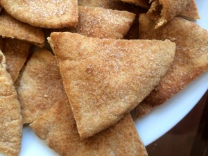 Homemade Cinnamon and Sugar Pita Chips piled on a plate