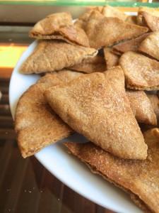 Homemade Cinnamon and Sugar Pita Chips piled on a plate