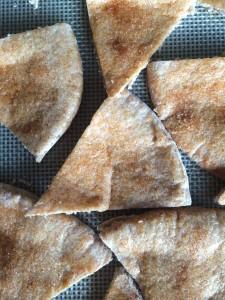 Homemade Cinnamon and Sugar Pita Chips on a baking tray