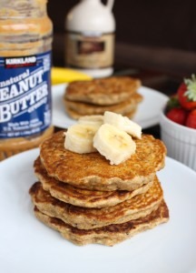 a stack of Whole Wheat Banana Pancakes topped with banana slices
