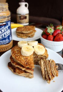 a fork stabbing into some Whole Wheat Banana Pancakes
