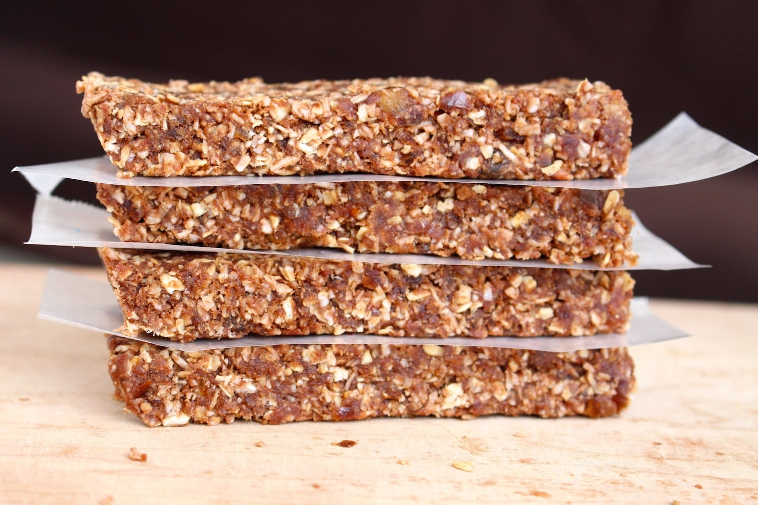 Easy homemade oatmeal date granola bars easy homemade oatmeal date granola bars separated by parchment paper ccuart Image collections