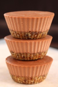 raw mini chocolate cheesecakes stacked on each other