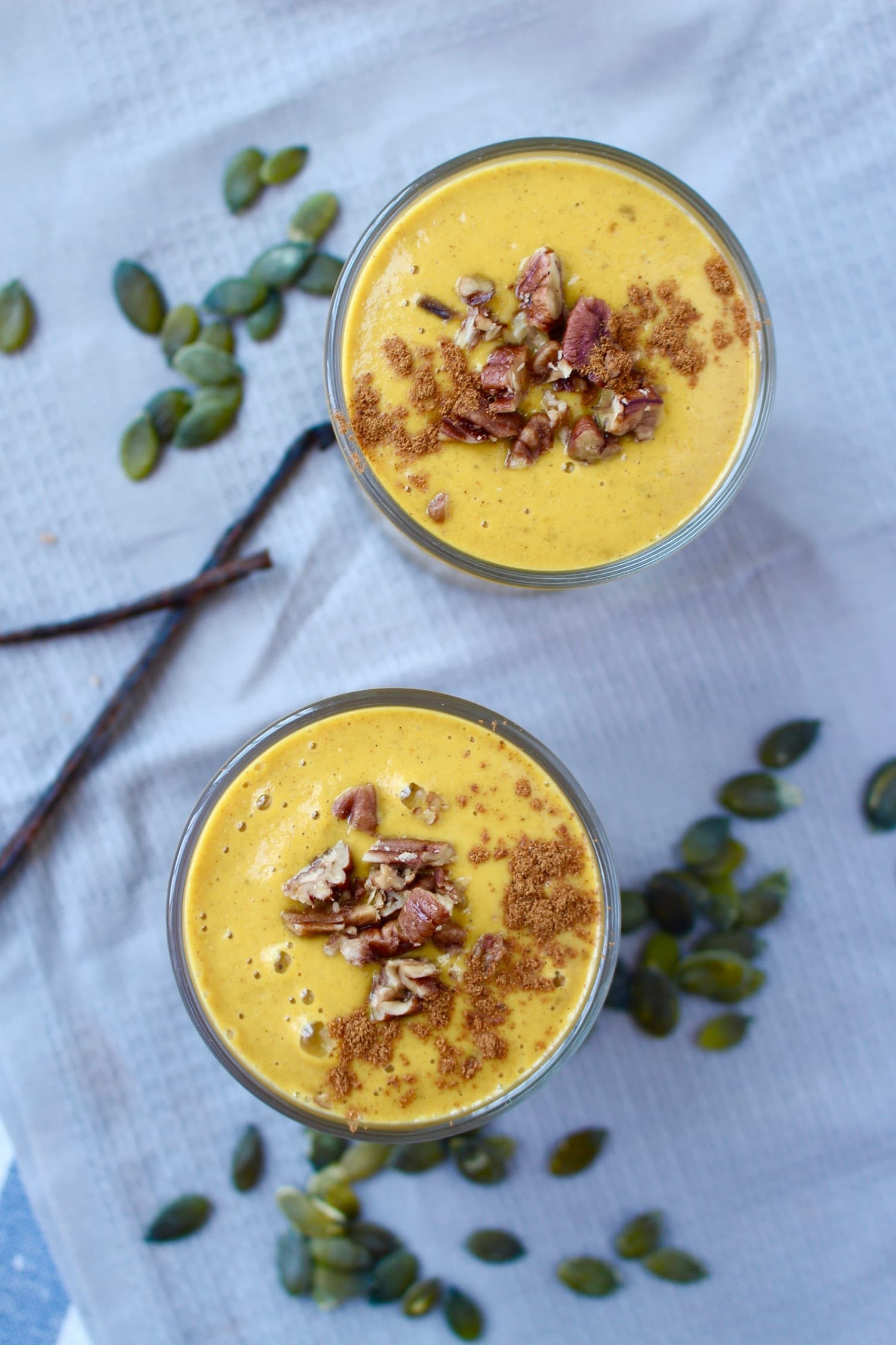 Banana-Less Pumpkin Pie Smoothie topped with cinnamon and cacao nibs