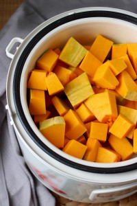 cubed pumpkin in a steamer basket