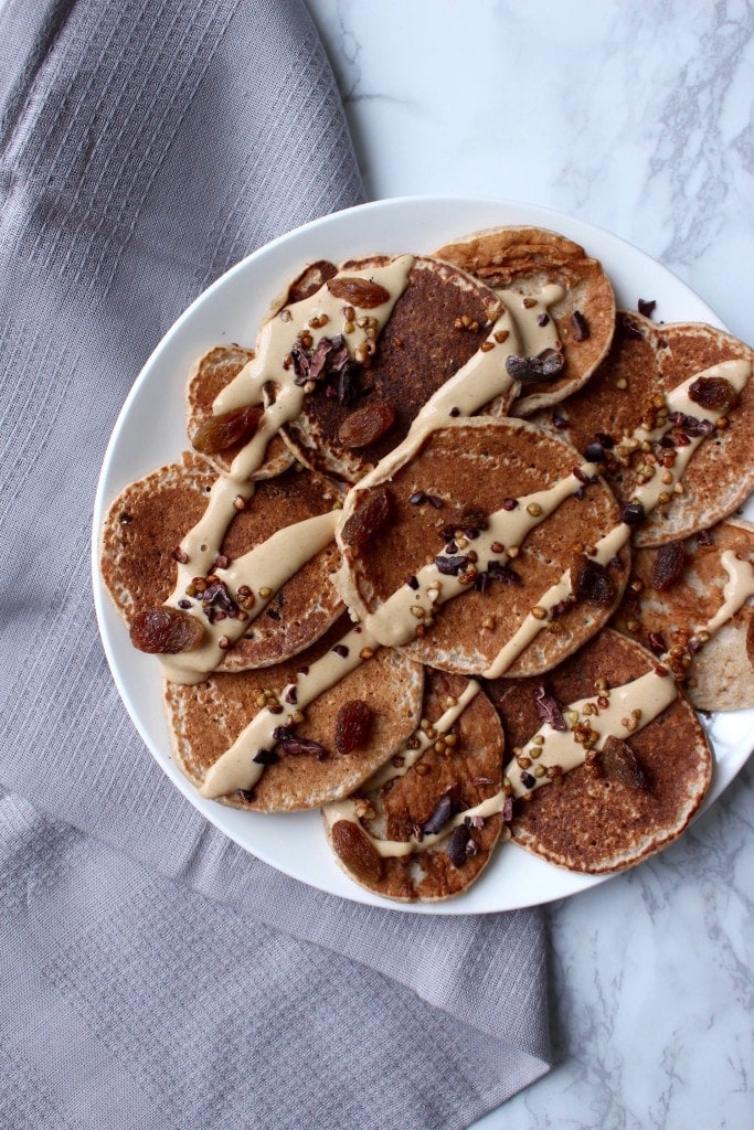 2 Ingredient Oatmeal Banana Blender Pancakes with Chocolate Pumpkin Spread on a plate top view