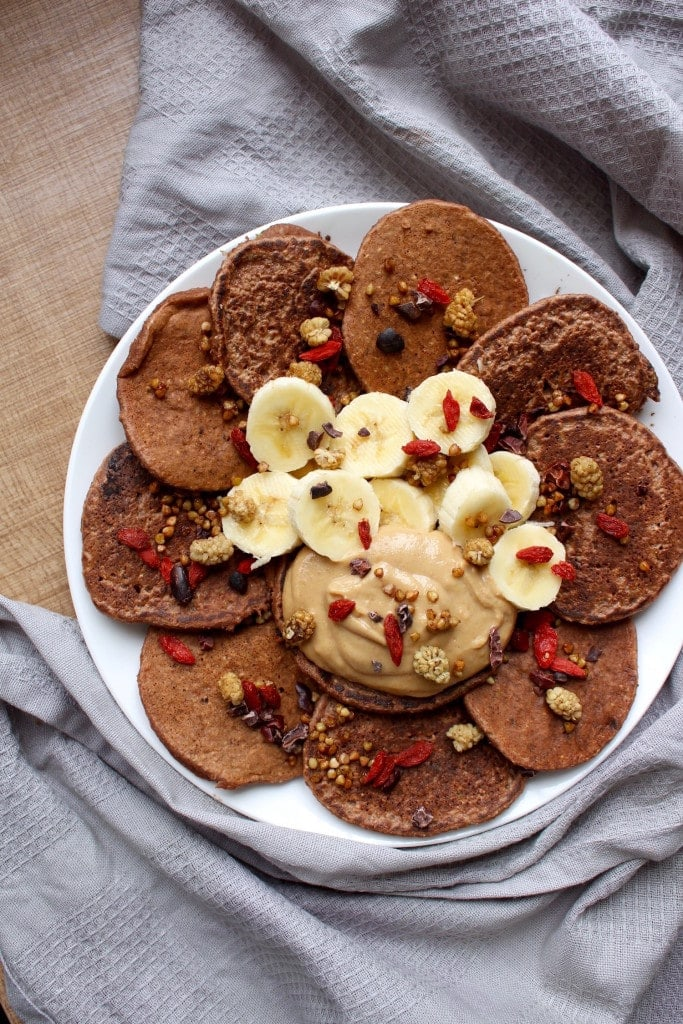 2 Ingredient Oatmeal Banana Blender Pancakes with Chocolate Pumpkin Spread on a plate top view with towel
