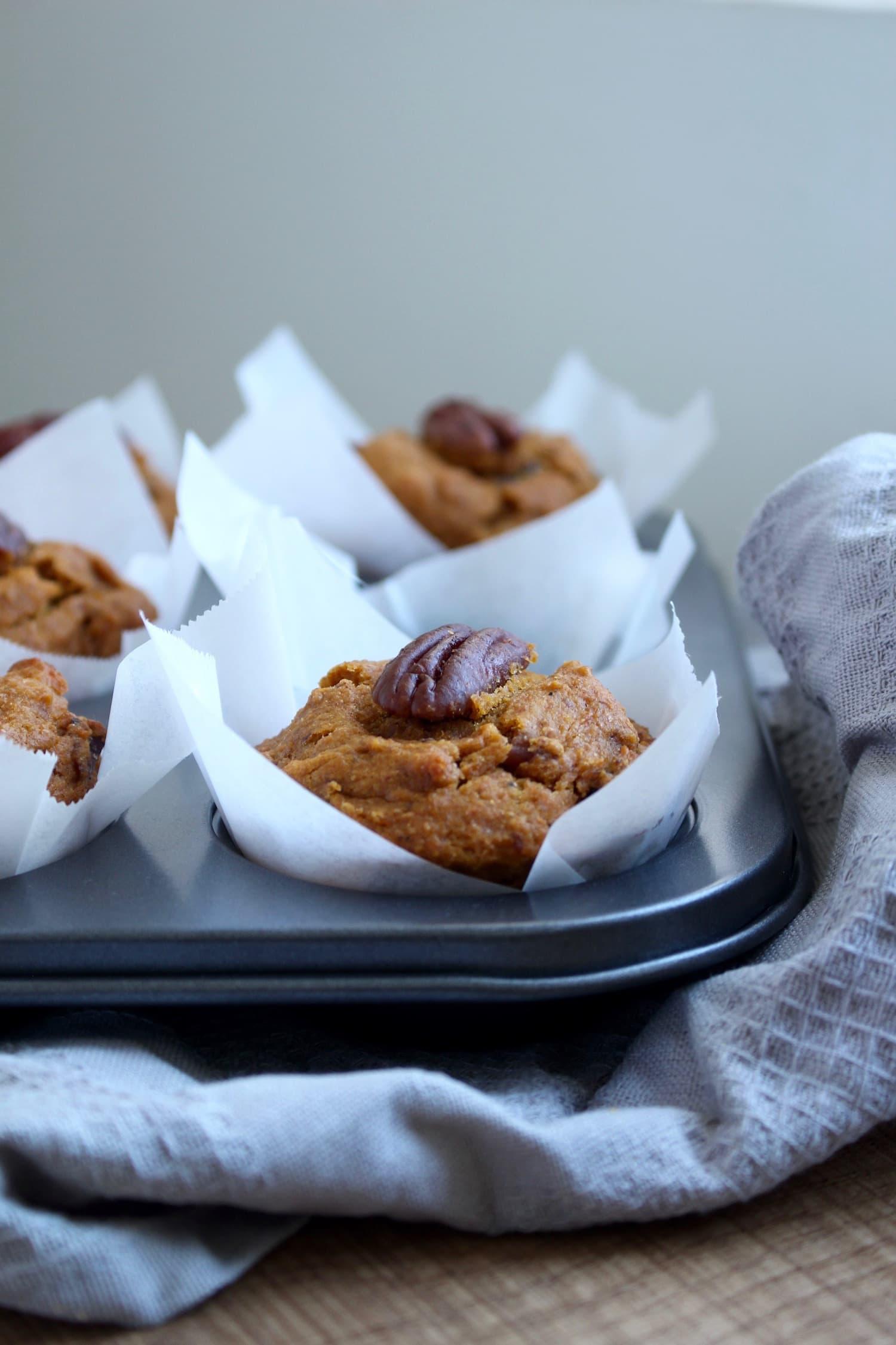 Vegan Pumpkin Pecan Muffins in a muffin pan