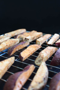 sweet potato wedges on a baking rack