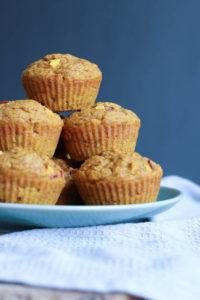 vegan pumpkin nectarine oatmeal muffins stacked on a plate