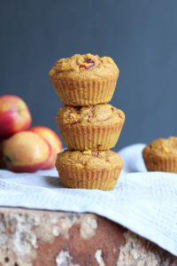 Pumpkin nectarine oatmeal muffins stacked on each other