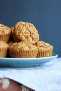 Pumpkin nectarine oatmeal muffins piled on a plate