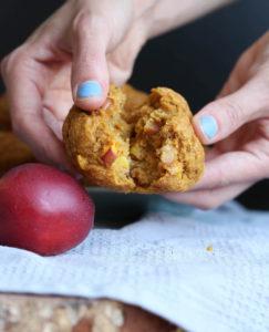 breaking open a warm pumpkin nectarine oatmeal muffin