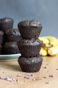The BEST Double Chocolate Black Tahini Banana Muffins! These muffins are my newest obsession! Made with rich black tahini and gooey sweet chocolate, these Double Chocolate Black Tahini Banana Muffins are a healthy and delicious way to satisfy your sweet tooth!