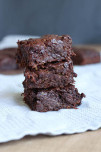 Three Vegan Zucchini Brownies stacked on each other