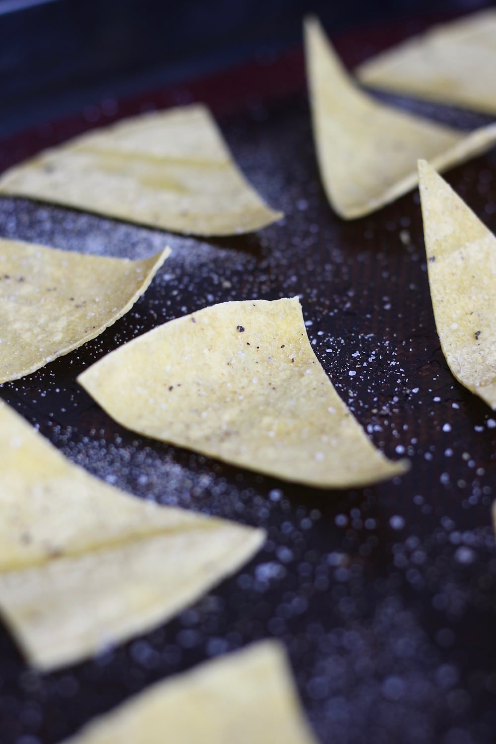 Tortilla chips being baked in the oven