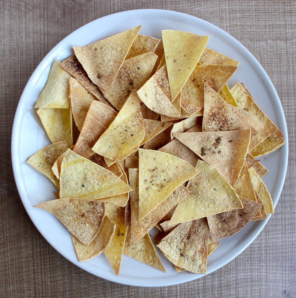a plate of homemade, oil-free baked tortilla chips