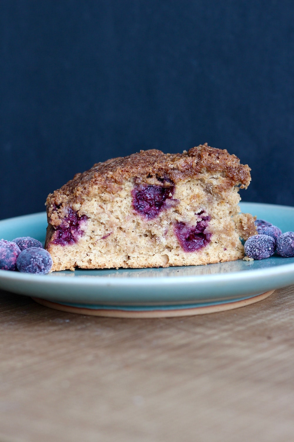 Vegan Blueberry Coffee Cake on plate a plate with more blueberries