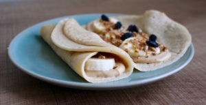 Filling Vegan Crepes with banana, peanut butter and granola