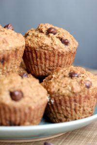 Vegan Oil Free Oat Bran Applesauce Muffins stacked on a plate