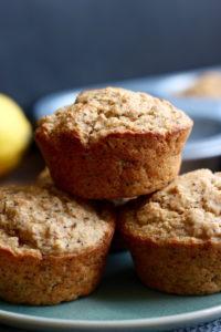 Jumbo Vegan Lemon Poppy Seed Muffins stacked on a plate