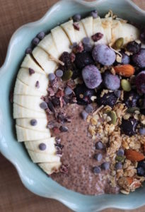 Close up of chocolate chia seed pudding with toppings