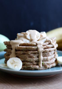 Vegan Zucchini Bread Pancakes drizzled with peanut butter