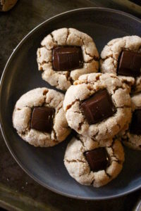 vegan peanut butter blossom cookies piled on a plate