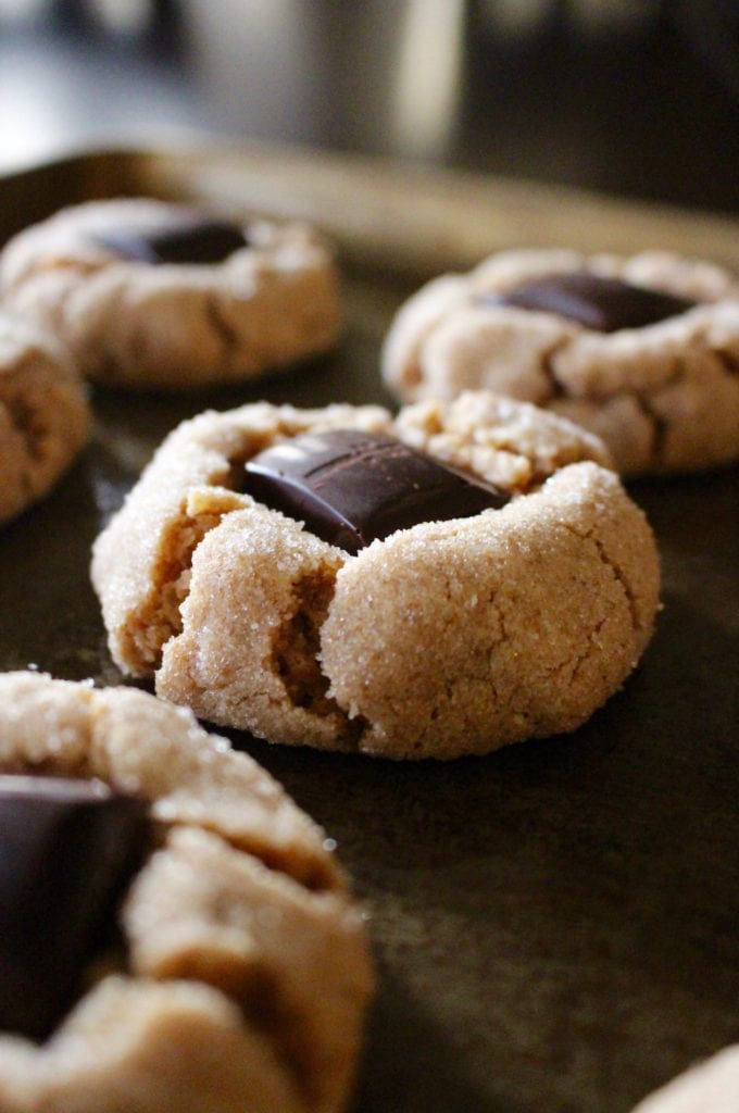 vegan peanut butter blossom cookies on a baking tray