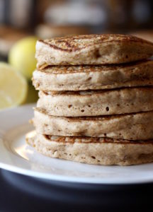 Vegan Whole Wheat Lemon Yogurt Pancakes stacked on a plate