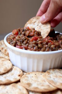 2 Ingredient Trader Joe's Lentil Bruschetta Dip being scooped up with a cracker