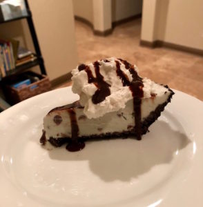 vegan ice cream cake with whipped cream and syrup