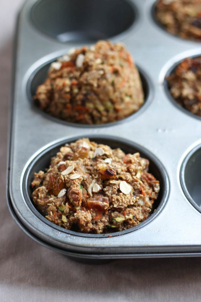 Zucchini Carrot Oatmeal Breakfast Muffins in a muffin pan