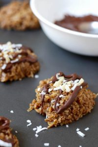 Chocolate drizzled on Almond Butter Coconut No Bake Cookies