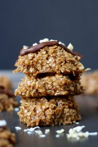 Almond Butter Coconut No Baked Cookies stacked on a pan