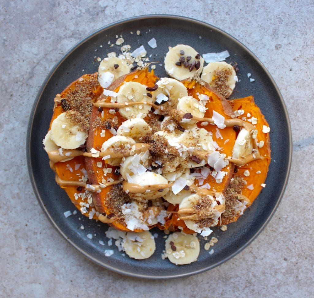 Sweet potato topped with banana, peanut butter and ground flaxseed