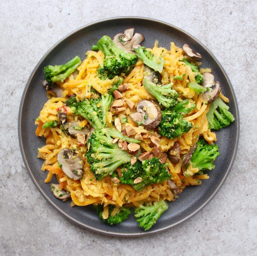 Cheesy Hummus Butternut Squash Noodles with broccoli and mushrooms