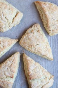 golden brown scones on a baking sheet