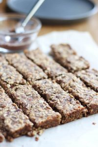 Chewy Almond Butter Date Granola Bars lined up in a row