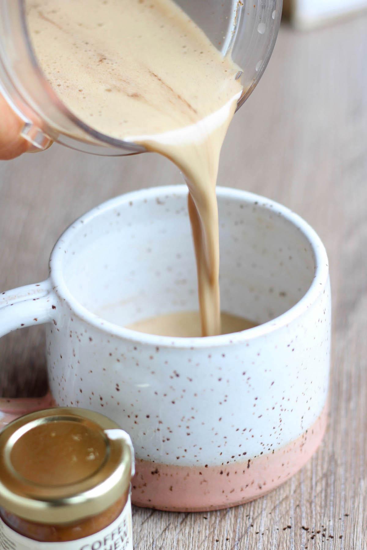 pouring vegan bulletproof coffee into a mug