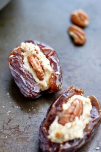Vegan Cream Cheese Stuffed Dates on a cookie tray