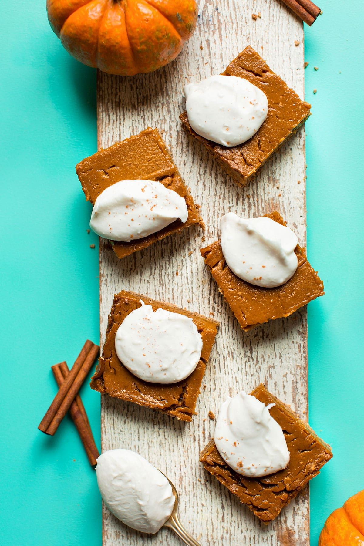 Pumpkin Pie Bars topped with coconut whipped cream