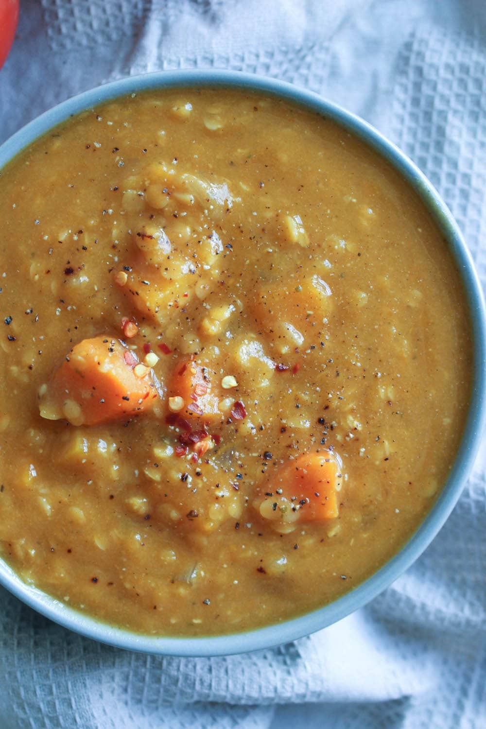 Red Lentil Pumpkin Soup topped with red chili flakes