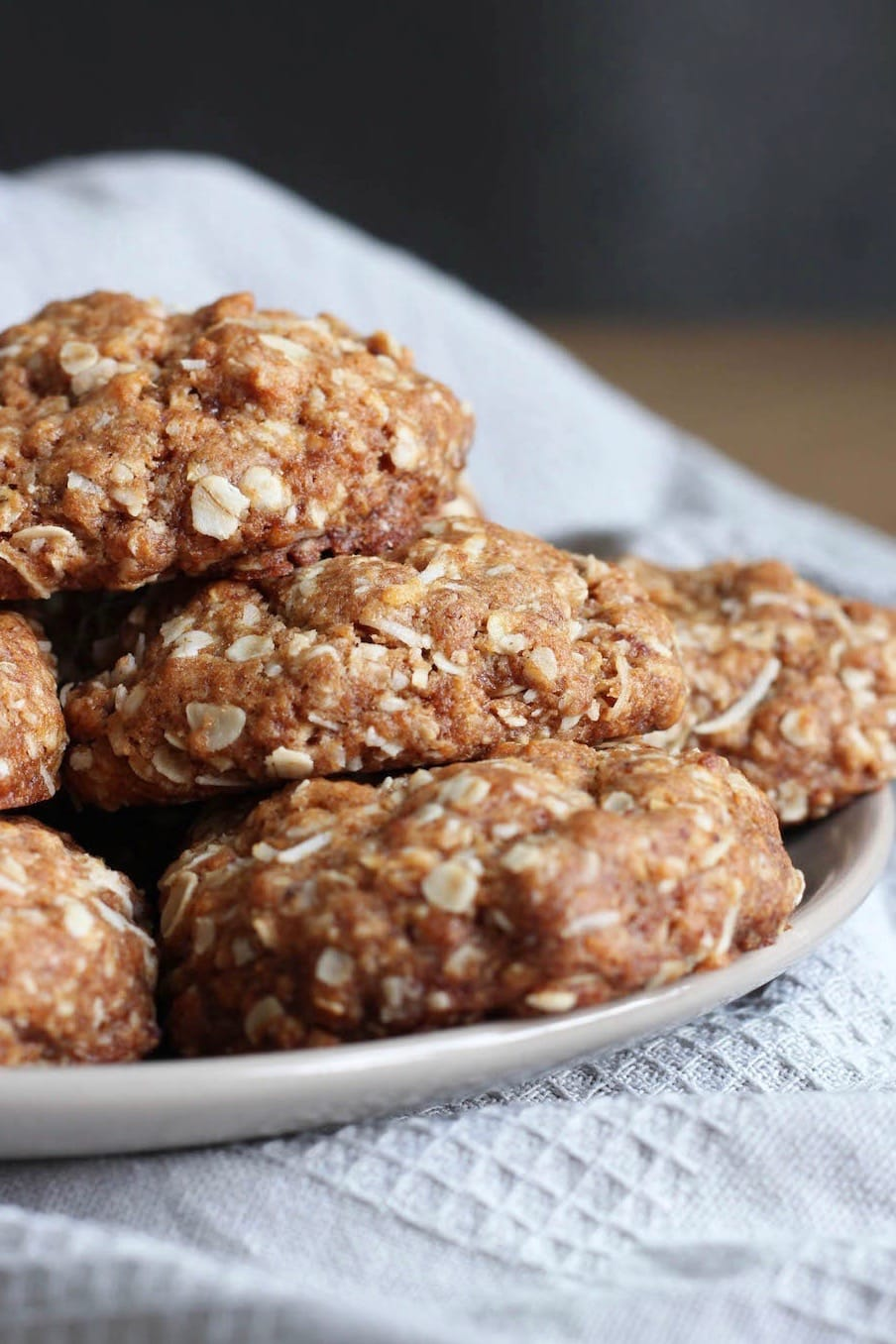 Vegan Coconut Oatmeal Cookies stacked on a plate