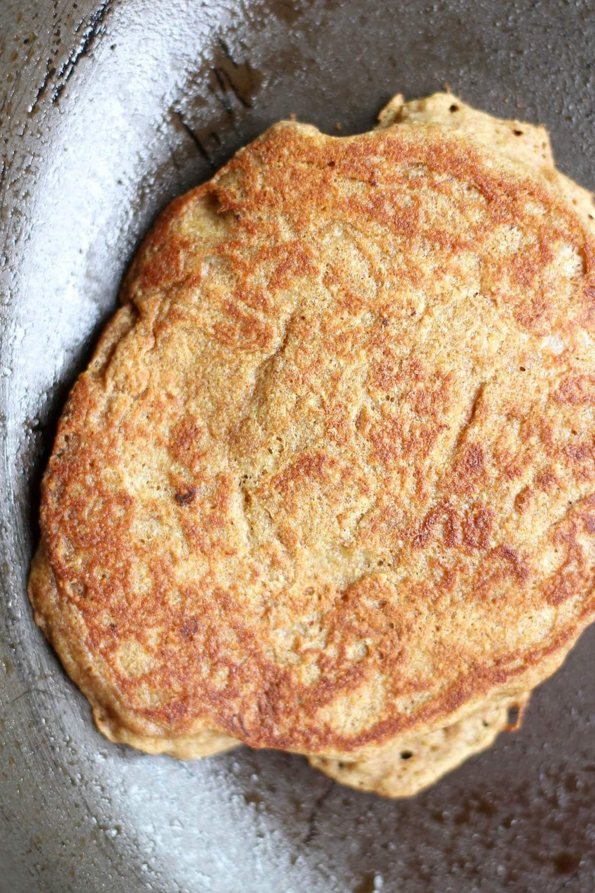 golden brown gluten free pancakes on a pan