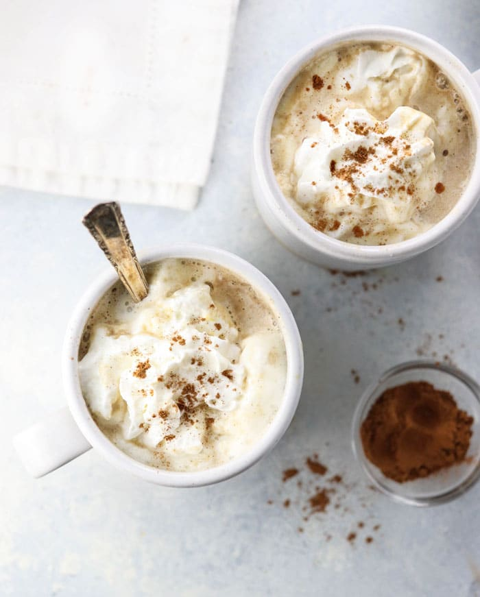Pumpkin Spice Latte topped with whipped cream and cinnamon