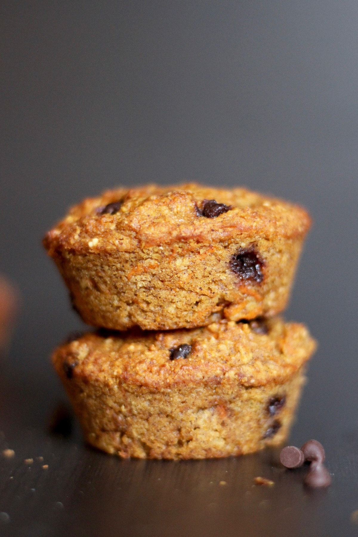 two carrot chocolate chip muffins stacked on each other