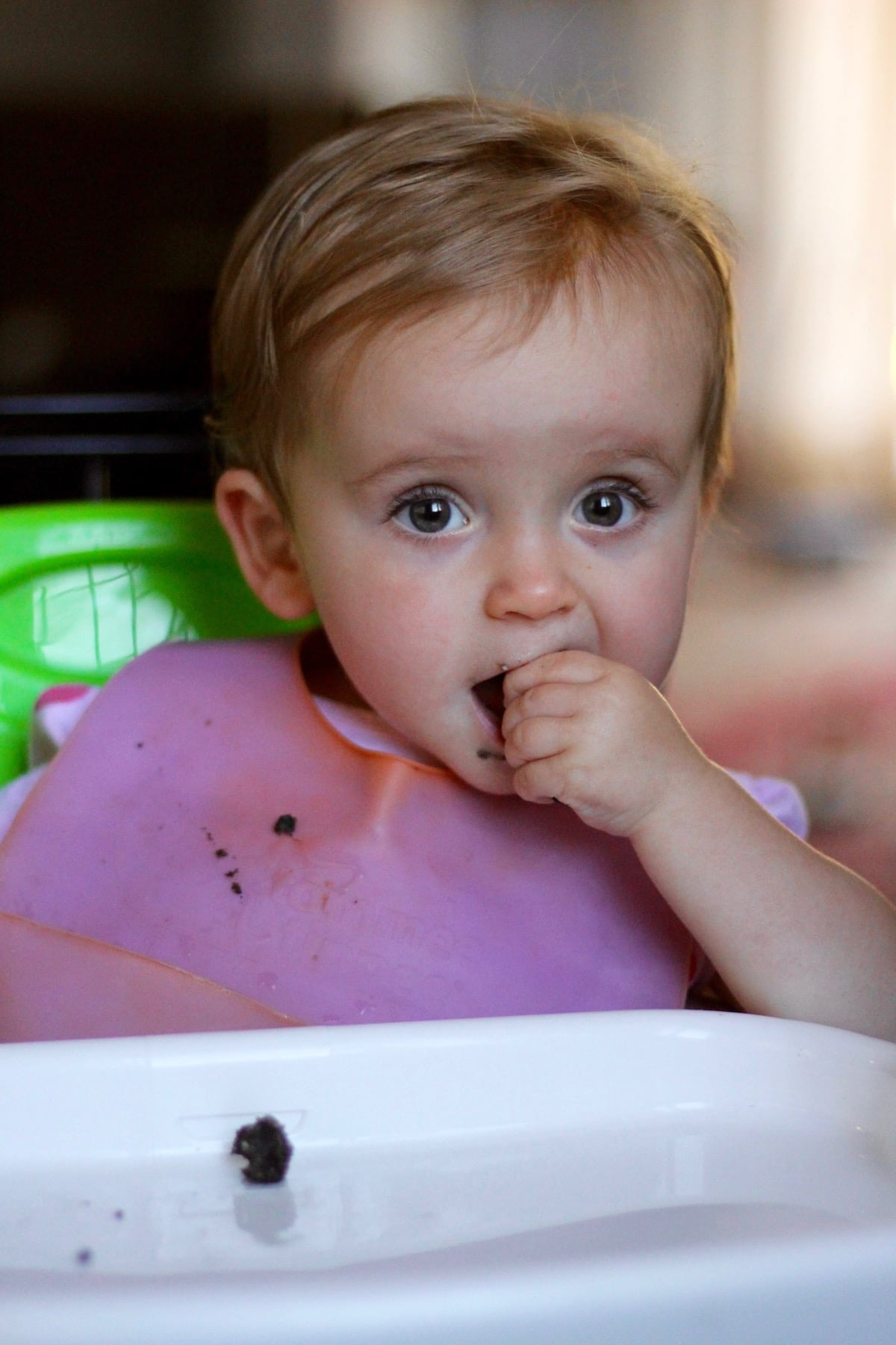 1 year old girl enjoying a tahini date bar